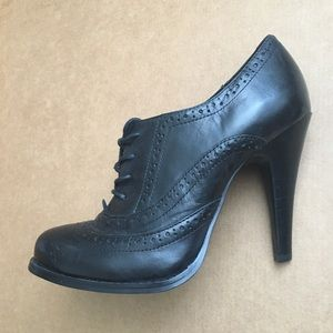 Black oxford style leather heels